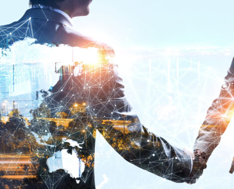Close up of two businesspeople shaking hands against modern cityscape background. 3d rendering